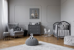 "Baby room in grey with crib, chair, dress, and rocking horse. Perinatal mental health is very important in the first year for women. It is time to prioritize self-care for women. Being new parent can cause you to experience ""new parent guilt"". Never fear, you can overcome the anxiety with my postpartum anxiety toolkit. Begin learning today and practice postpartum mindfulness"