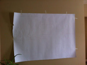 tape paper with frame outlines to wall