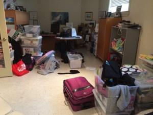 room full of storage bins before