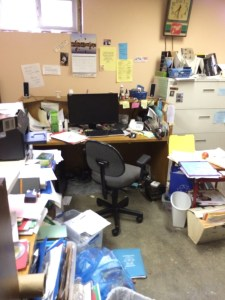 office overflowing with paperwork