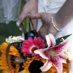 Sunflower, pink Gerbera Daisy, Stargazer Lily, and Wheat bridal bouquet // Design: Jessica Ormond Events. Lubbock Texas boutique wedding florist.