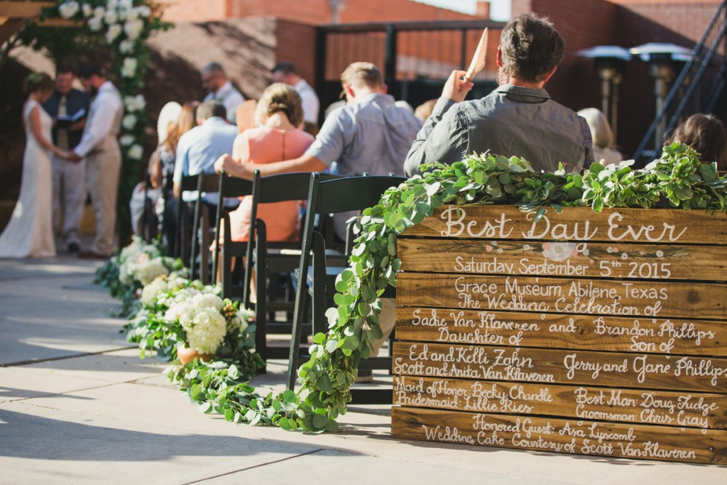 Handcrafted ceremony sign with garland. Jessica Ormond Events - Abilene and Lubbock Texas boutique wedding florist and planner. Mia Coelho Photography.