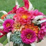Vibrant bouquet of dahlias, zinnias, and succulents designed by Jessica Ormond Events.