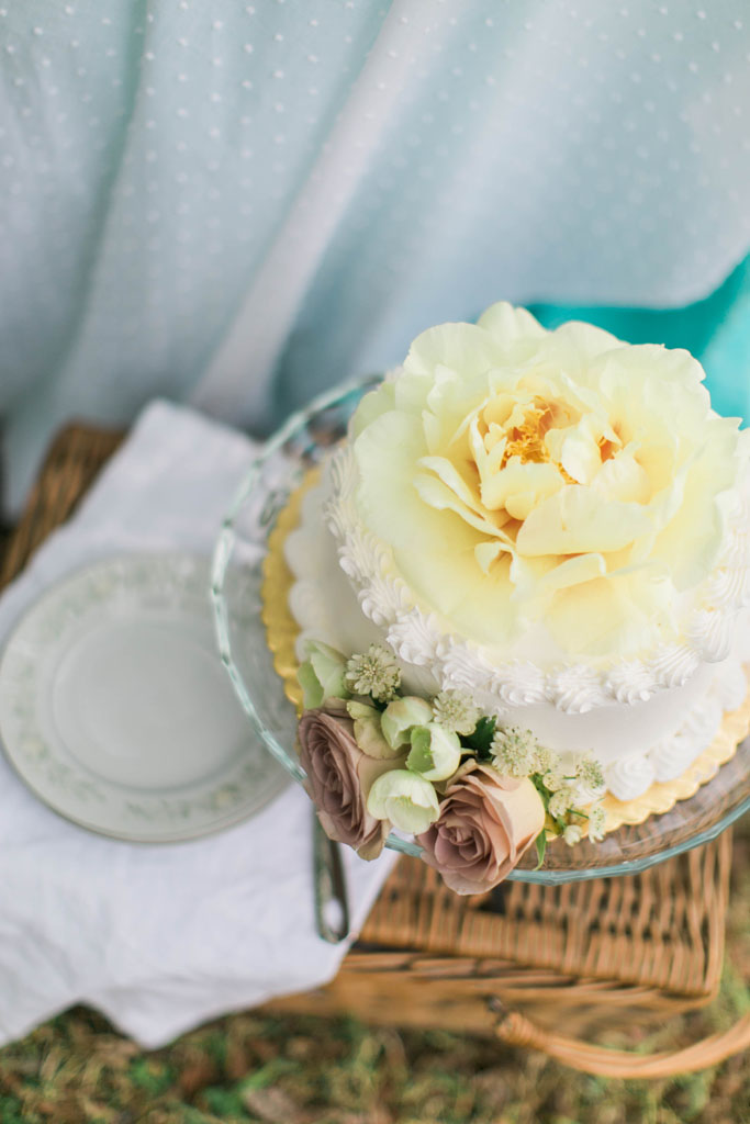 Wedding cake with yellow peony and yellow rose china. Flowers and styling Jessica Ormond Events. Photography Emily Koontz.