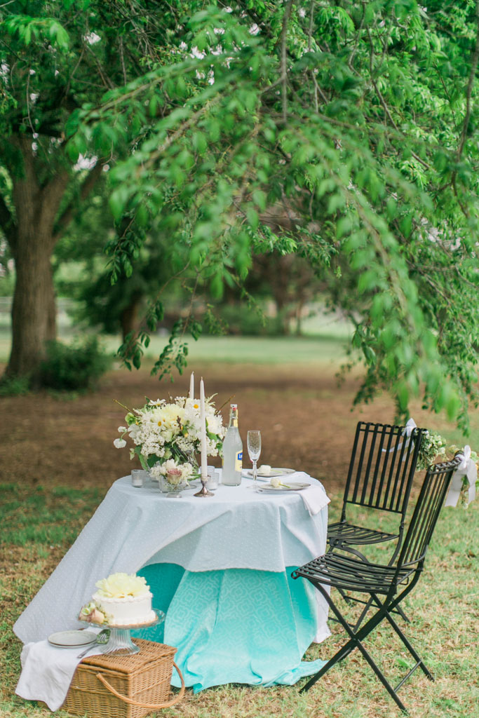 Intimate garden style sweetheart table. Flowers and styling Jessica Ormond Events. Photography Emily Koontz.