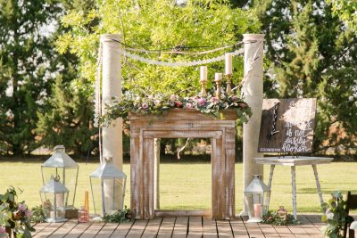 Outdoor ceremony with fireplace, candles, and lanterns. Cotton Creek Barn. Flowers and Planning by Jessica Ormond Events. Photo by Allee J Photography.