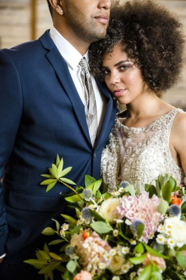 Sweet and glamorous couple at Eberley Brooks Events. Lubbock florist Jessica Ormond Events. Photo by Caitlin and Ryan Photography.