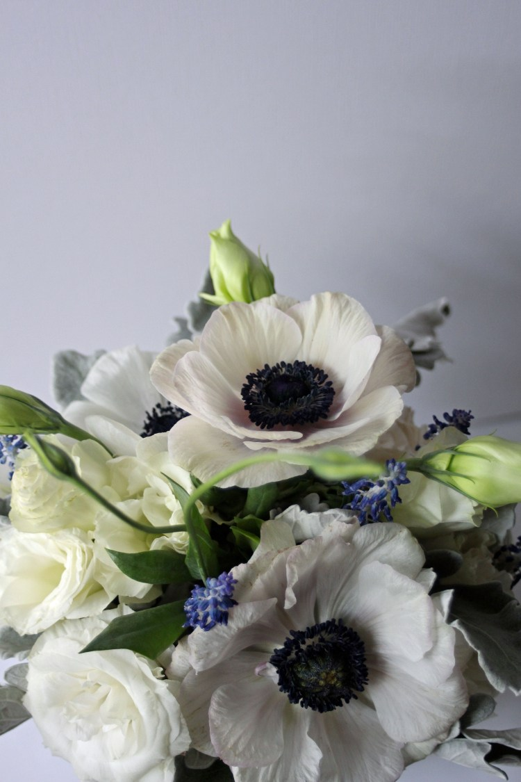 Anemone toss bouquet for Lubbock wedding at the Texas Tech Club. Designed by Jessica Ormond Events.