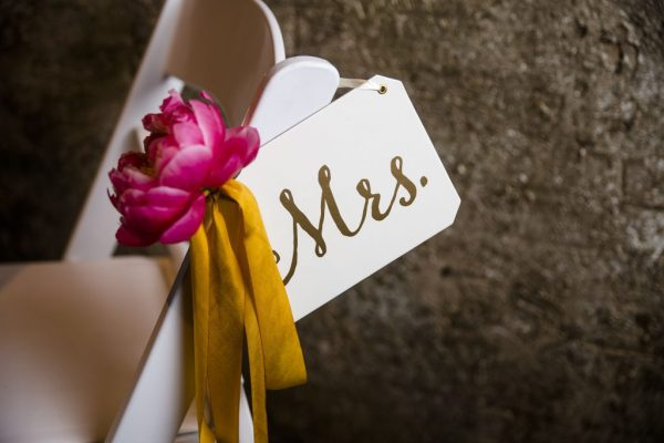 Mrs sign and peony chair marker styled by Jessica Ormond Events. Caitlin & Ryan Photography.