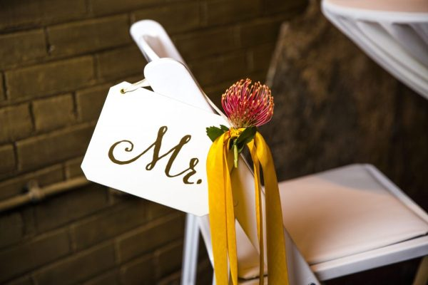 Mr sign and protea chair marker styled by Jessica Ormond Events. Caitlin & Ryan Photography.