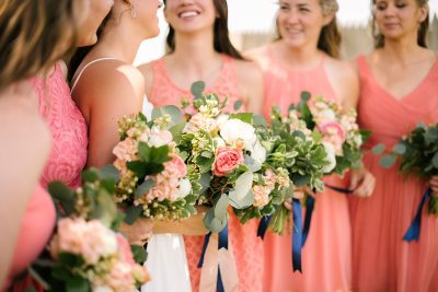Fresh coral and white garden style bouquets for Lubbock Texas summer wedding. Floral designer Jessica Ormond Events. Picture by Amanda Scott Photograhy.
