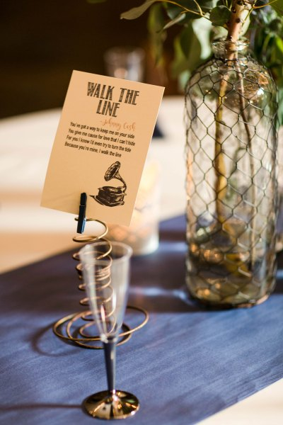 Vintage details and song lyrics on reception tables. Wedding planner Jessica Ormond Events and Photographer Allee J of Lubbock Texas.