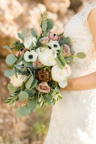 Wild bridal bouquet of peonies and anenomes designed by Texas wedding florist Jessica Ormond Events. Photo by Allee J.