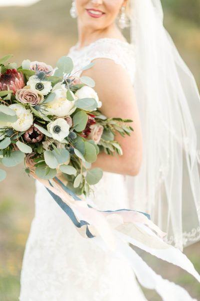 Bridal bouquet with flowing silk ribbon. Designed by florist Jessica Ormond Events. Photo by Allee J.