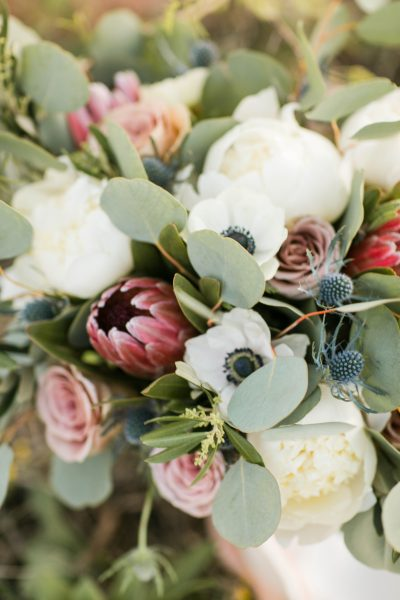 Close up of peony protea anenomy and thistle bridal bouquet designed by Jessica Ormond Events and photographed by Allee J.