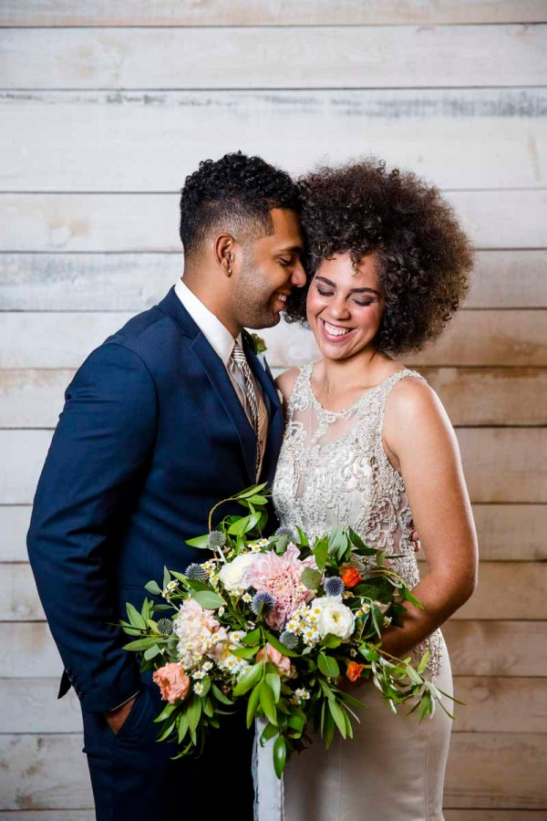 Bride and groom with cafe latte dahlia bouquet in Eberley Brooks Events. Designed by Lubbock florist Jessica Ormond Events. Caitlin and Ryan Photography.