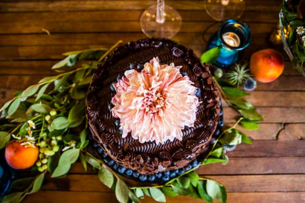 Chocolate cake with Cafe Latte Dahlia on the bar at Eberley Brooks in West Texas. Wedding Planner Jessica Ormond Events. Photography by Caitlin and Ryan Photography.