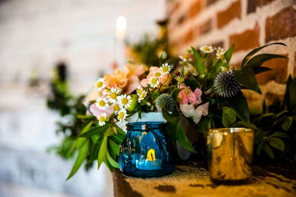 Chamomile and greens on fireplace mantel at Eberley Brooks. Wedding florist Jessica Ormond Events. Texas photographer Caitlin and Ryan Photography.