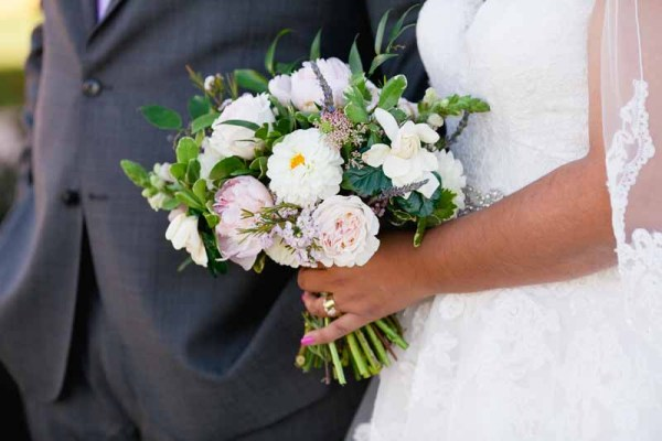 Bridal bouquet of gardenia, peonies, garden roses, and dahlias designed by Texas wedding florist Jessica Ormond Events. Linda McMillan Photograph.