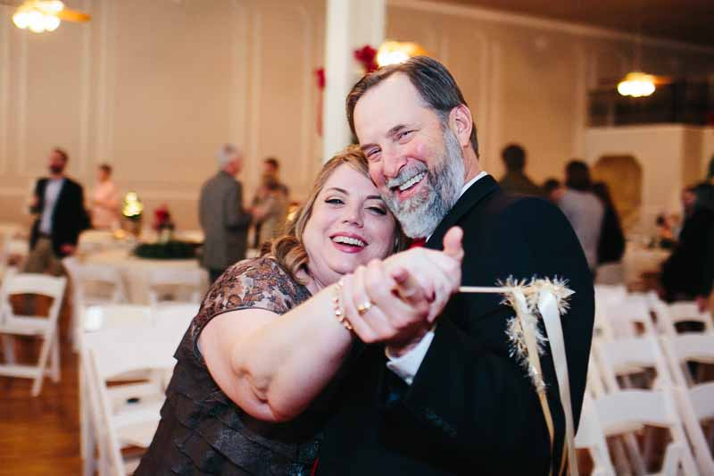 Brides parents dancing at Christmas reception at the historic Watson Building. Texas Wedding planner Jessica Ormond Events. Photo by Betsy.