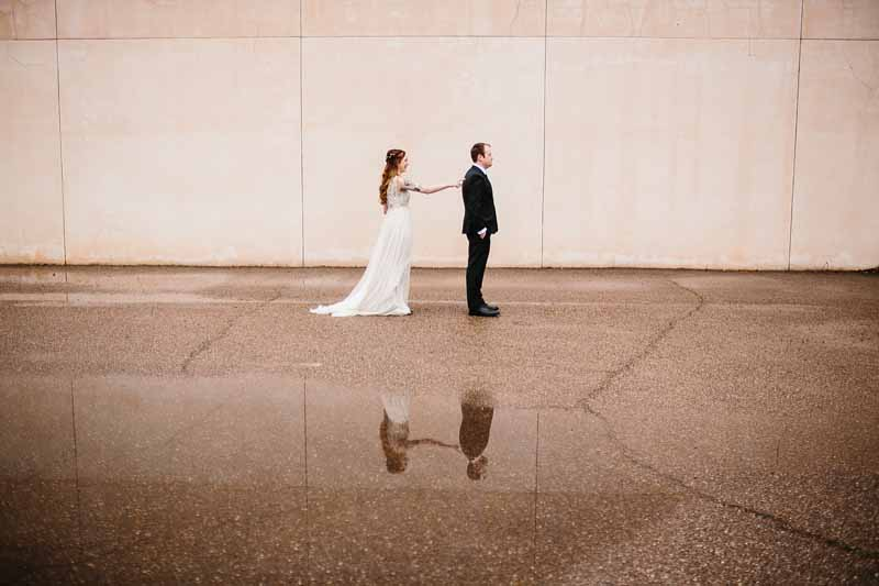 Rainy first look at urban Texas wedding. Photographer Photo by Betsy. Planner Jessica Ormond Events.