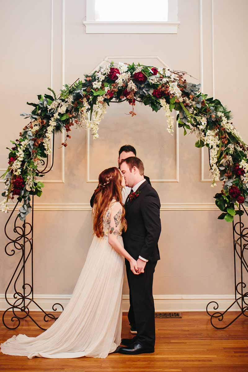First kiss at Texas December wedding at the Watson Building. Photo by Betsy. Planning by Jessica Ormond Events.