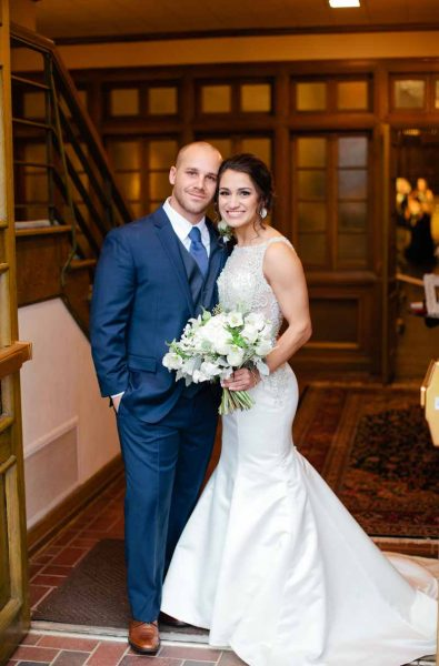Texas bride and groom at winter Lubbock ceremony. Wedding flowers by Jessica Ormond Events. Tara Hobgood Photographer.