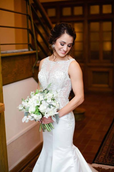 Texas bride with white Hellebore bouquet in elegant trumpet gown. Winter bouquet of Hellebore, Hydrangea, and Dusty Miller designed by Jessica Ormond Events. Tara Hobgood Photographer.