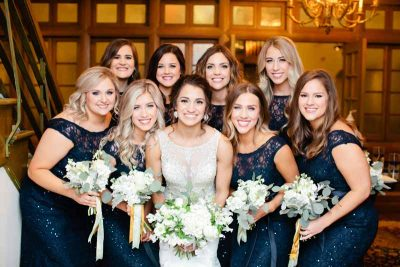 Bride and bridesmaids at the with white winter bouquets of roses and eucalyptus designed by wedding florist Jessica Ormond Events. Picture by Texas photographer Tara Hobgood.