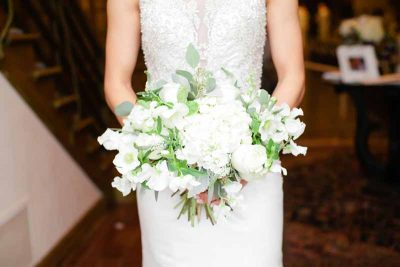 Classic white winter bridal bouqeut of hydrangea, roses, sweet peas and hellebore designed by Texas wedding florist Jessica Ormond Events. Tara Hobgood Photography.