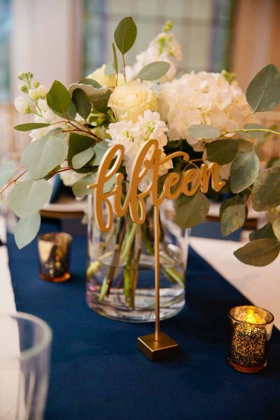 White hydrangea centerpiece designed by Lubbock Texas wedding florist Jessica Ormond Events. Photo by Tara Hobgood Photography