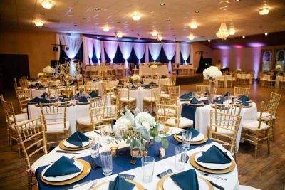 Gold and navy winter Texas wedding reception. Venue: Legacy Event Center in Lubbock Texas. Florist: Jessica Ormond Events. Photographer: Tara Hobgood.
