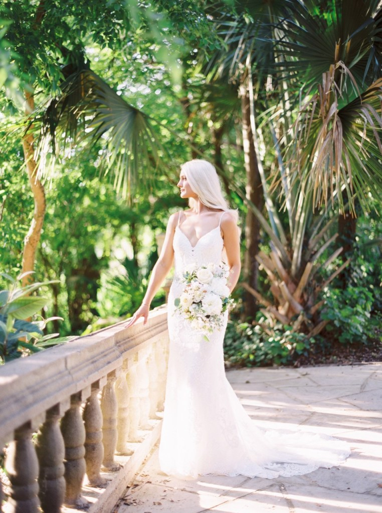 Bridal portraits with an old world and tropical vibe at the The Contemporary Austin - Laguna Gloria. Taken by May Carlson Photography. Flowers provided by Texas florist Jessica Ormond Events.