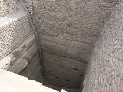 A grain silo in the Step Pyramid complex. Access to the bottom of the silo is from the steps in the pit next to it.