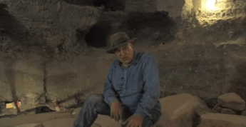 Dr. Zahi Hawass sitting in Djoser's tomb after the rubble had been cleared. It is a vertical shaft under the Step Pyramid - much like other shafts in the complex used to store grain.