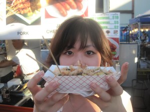 Takoyaki = crispy outside and half-cooked batter inside.  Oishi!