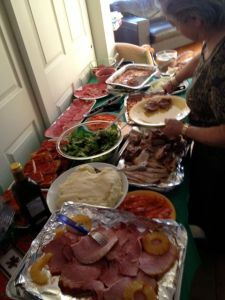The spread includes mom's pasta and eggplant parmesan, and Akemi's gravlax.