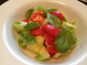 Market fresh tomato and basil salad with olive oil.