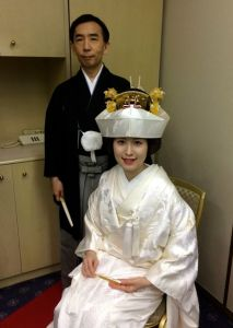 The groom and bride in their traditional Japanese wedding wear.