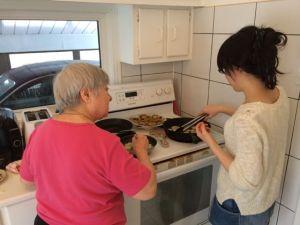 Akemi and mom work on the fried eggplant