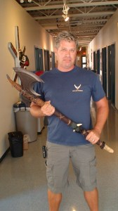 Production Designer James Robbins shows off the finished product.  I think the blade may still need a little work.