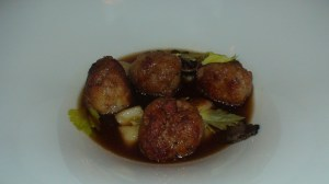 Veal meatballs with gnocci in black truffle brodo