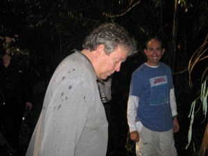 Director of Photography Jim Menard suddenly realizes he's standing in a puddle - much to Director Robert C. Cooper's delight.