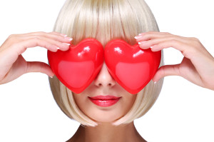 http://www.dreamstime.com/royalty-free-stock-photo-fashion-blonde-girl-red-hearts-valentines-day-glamorous-young-woman-short-bob-hairstyle-isolated-white-love-image36991595