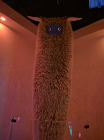 A creature from the immersive art exhibit