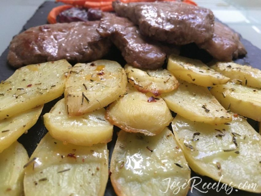 Patatas y carne de cerdo