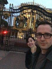A nice blurry photo of Buckingham Palace, at night.