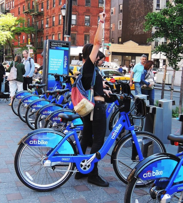 Excited person getting on a Citibike
