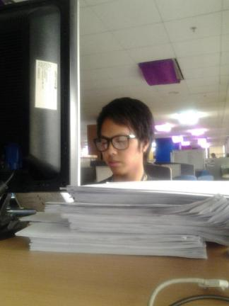 A photo of me working as an ACES Encoder. Photo was taken last 2012.