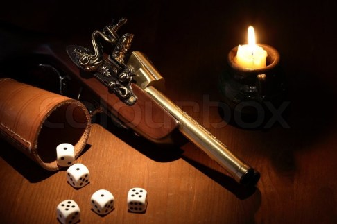 1917575-vintage-still-life-with-old-pistol-and-dice-near-lighting-candle-on-wooden-surface